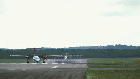 Turboprop Bombardier Dash 8 leave to taxiway Footage