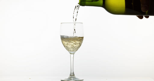 White Wine being poured into Glass, against White Background, Slow motion 4K Live Action