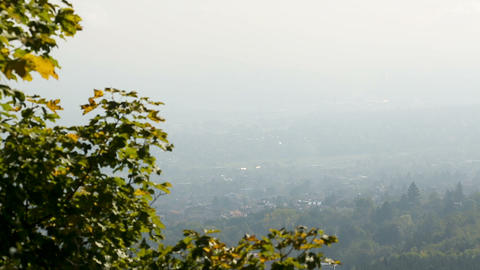 City lying at foot of mountain in thick haze, peaceful landscape, panorama view Footage