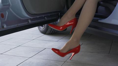 Slim female legs in red shoes, rich lady sitting in car, waiting for boyfriend Footage