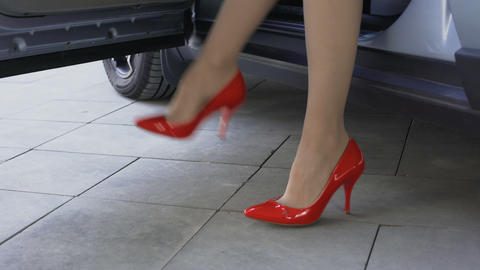 Sexy secretary wearing red shoes getting out of car and walking to the office Footage