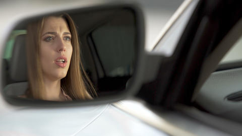 Beautiful upset woman sitting in automobile and crying, break-up and sadness Footage