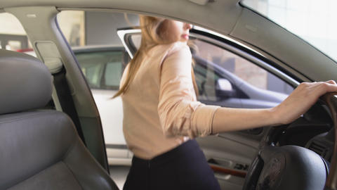 Confident female lawyer getting into automobile, professional driver, transport Live Action
