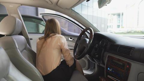 Nice woman getting out of car, showing green business card into camera, template Footage