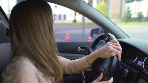 Beautiful business woman driving automobile in the city, transportation, traffic Footage