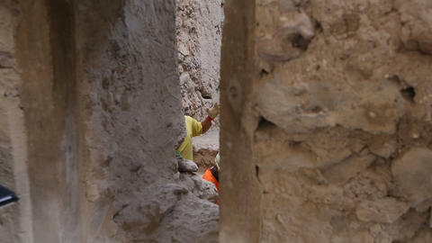 Archeologists working on dig of old village, solving problem, excavation site Footage