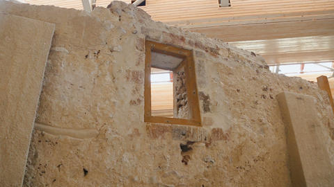Window in ancient stone wall, pile of stones, remains of settlement of Akrotiri Footage