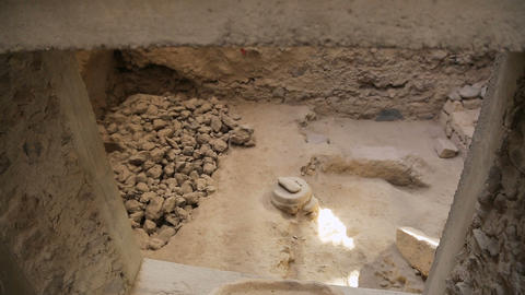 Room in ancient house shown through window, clay sink standing on window ceiling Footage