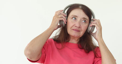 Mature woman listening music wireless headphones Footage