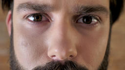 Eyes of young serious man with mustache, sadness, watching at camera Footage