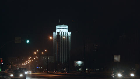 night city avenue with hard traffic and skyscraper Footage