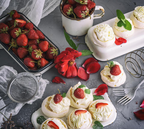 baked meringue with cream and fresh strawberries Photo