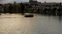 Tilt up from Vltava River to Charles Bridge Footage