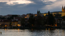 Pan to Prague Castle at dusk with city lights Footage