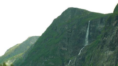 Landscape of huge, steep rocks and waterfall Footage
