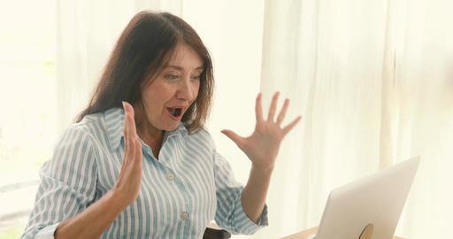 Elderly woman Cheering Success laptop Footage