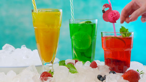 Preparing Summertime Spritzer drinks with fresh fruit, mango, berries, cucumbers Footage