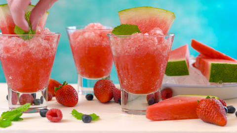 Preparing Summertime refreshing Watermelon granita desserts on a summery blue Live Action