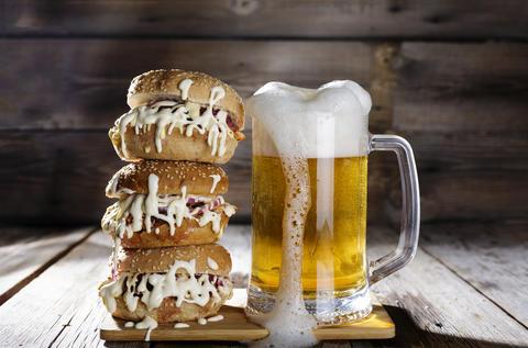 Street food. light beer, huge burger, beef patty, fast, meal, snack, pub Photo