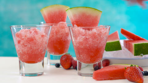 Preparing Summertime refreshing Watermelon granita desserts on a summery blue Footage