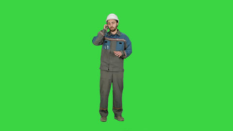 Construction Worker talk with Cell Telephone on a Green Screen, Chroma Key Footage