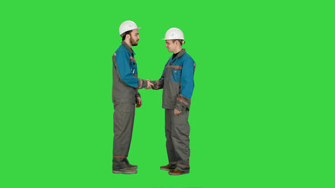 Two builder, architects handshaking on a Green Screen, Chroma Key Footage