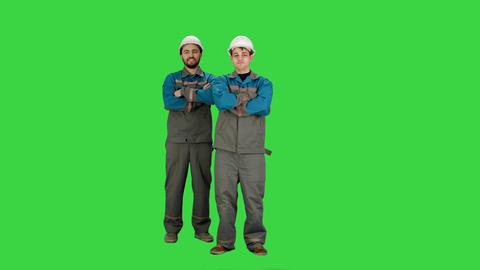 Industry, building, construction and people concept - happy male builders on a Footage