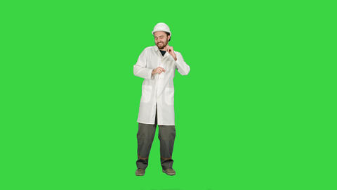 Funny dancing construction worker, architect, Electrician in helmet on a Green Footage