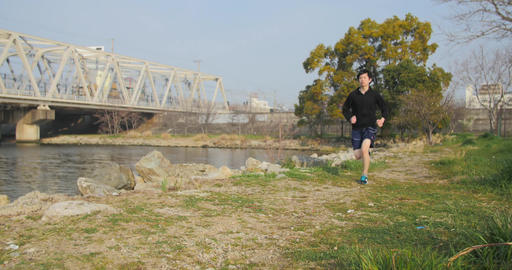 Japanese Runner running along the river training in Osaka 4K Footage