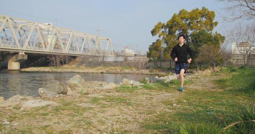 Japanese Runner running along the river training in Osaka 4K Footage