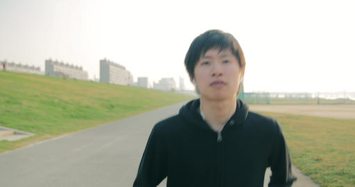 Japanese young runner running towards teh camera 4K Footage