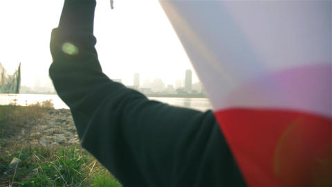 Sun shines through Japanese flag held by pround young Japanese Runner Live Action