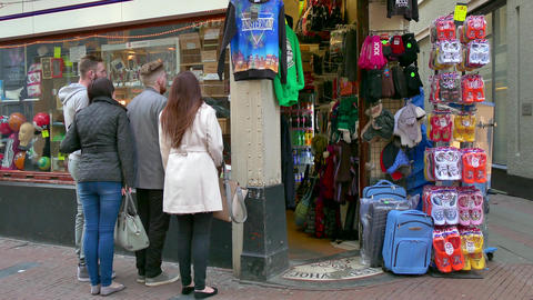 People Tourists Shopping For Souvenirs Gifts In Amsterdam Shop Store stock footage