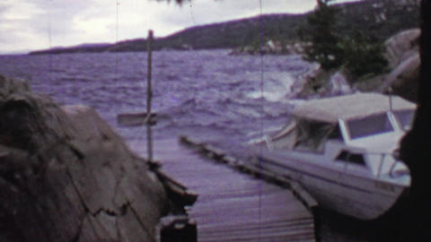 1957: Boat tossed around in stormy windy weather tied to dock Footage