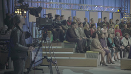 Cameraman and spectators in the TV Studio during the recording of the show Footage