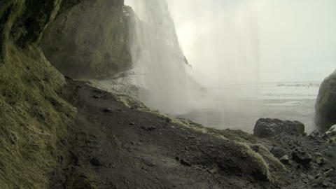 Behind the waterfall Seljalandsfoss in Iceland, wintertime Footage