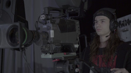 The cameraman shoots live in the TV Studio Footage