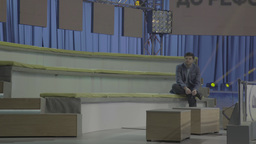 TV presenter in an empty TV Studio before broadcast Footage