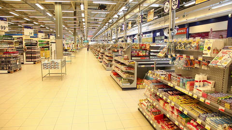 Shelves with goods in a large supermarket Footage