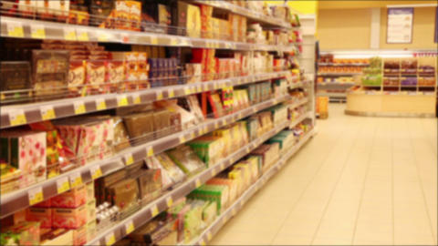 Shelves With Goods In The Supermarket. De Focused Footage