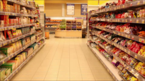 Supermarket Section With Products. De Focused Footage