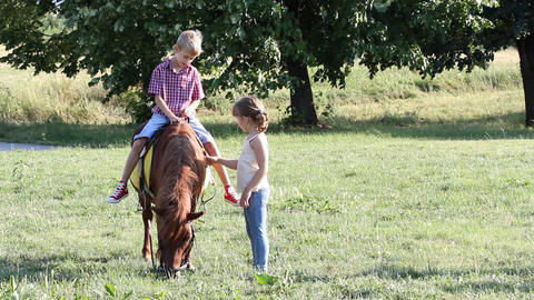 Happy boy and little girl with pony horse Footage
