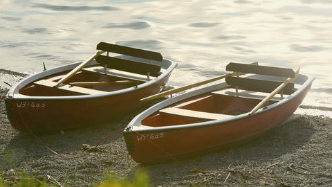 Rowing boats on the shore in evening sun Footage