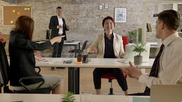 Business people of mixed ethnicity in office working and suddenly asian woman Footage