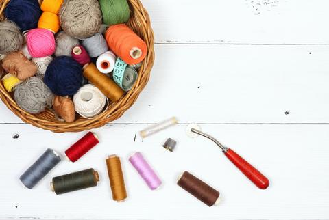 Composition with treads, cottons and sewing accessories Photo