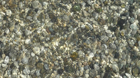 abstract background from light refraction of water and pebble on bottom Footage