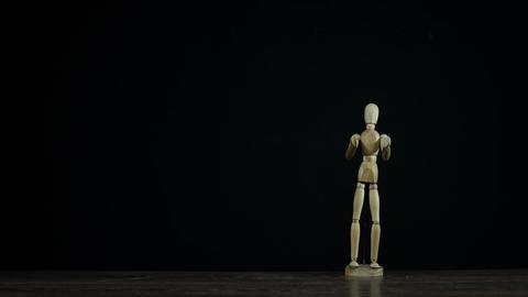 Stopmotion wooden figure dummy applauds in studio on... Stock Video Footage