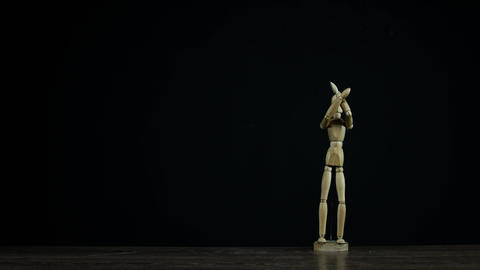 Stopmotion wooden figure dummy in studio on black background showing sign no Live Action