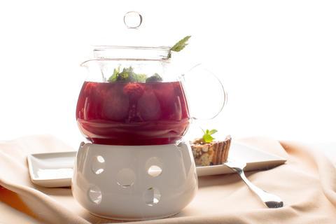 Pot with herbal tea Photo