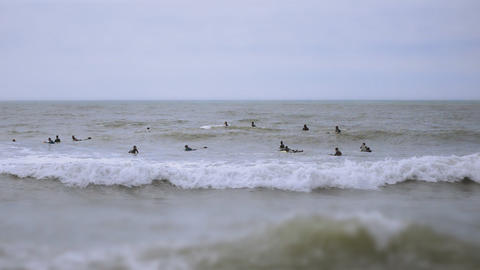 Tilt Shift Surfers On A Moody Day Footage